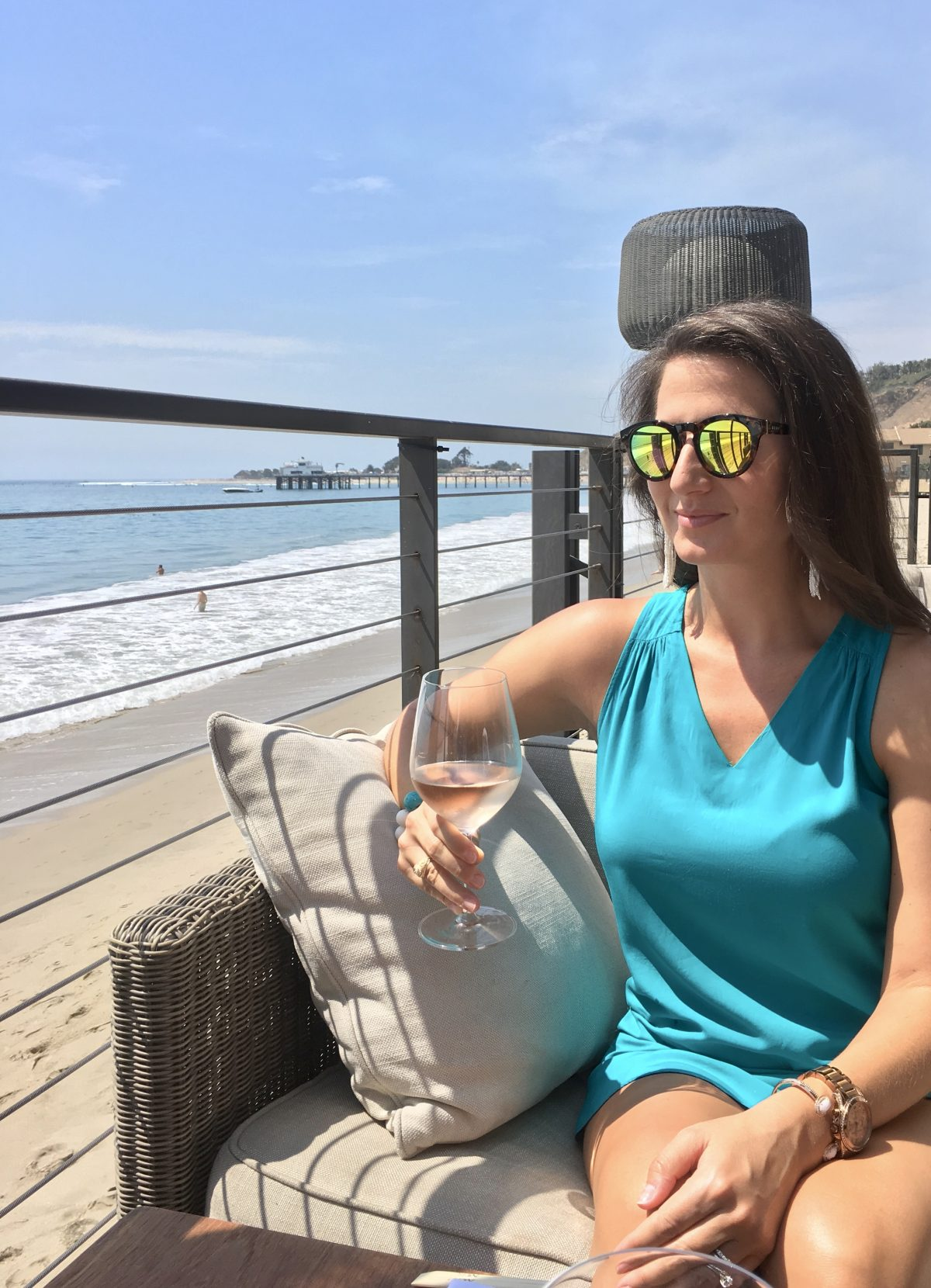 Erin Cathedrals and Cafes blog drinking rosé wine at Nobu restaurant, Malibu, California