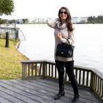 Erin from Cathedrals and Cafes blog carries the Rivington Convertible Mini Tote from Henri Bendel while wearing sunglasses