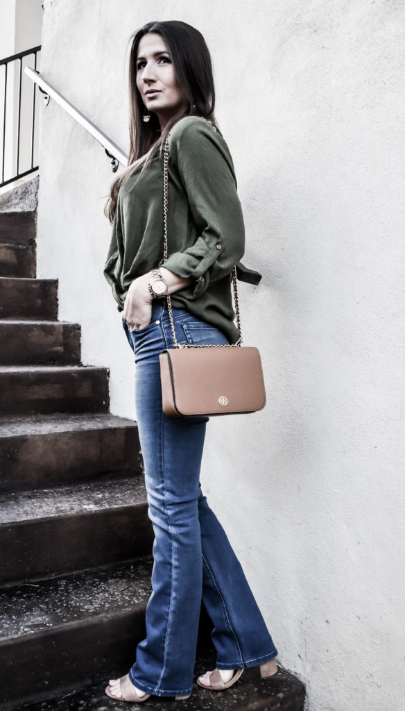 Erin from Cathedrals and Cafes Blog models a hi-low top with Diane Gilman DG2 Jeans and a shoulder bag from Tory Burch