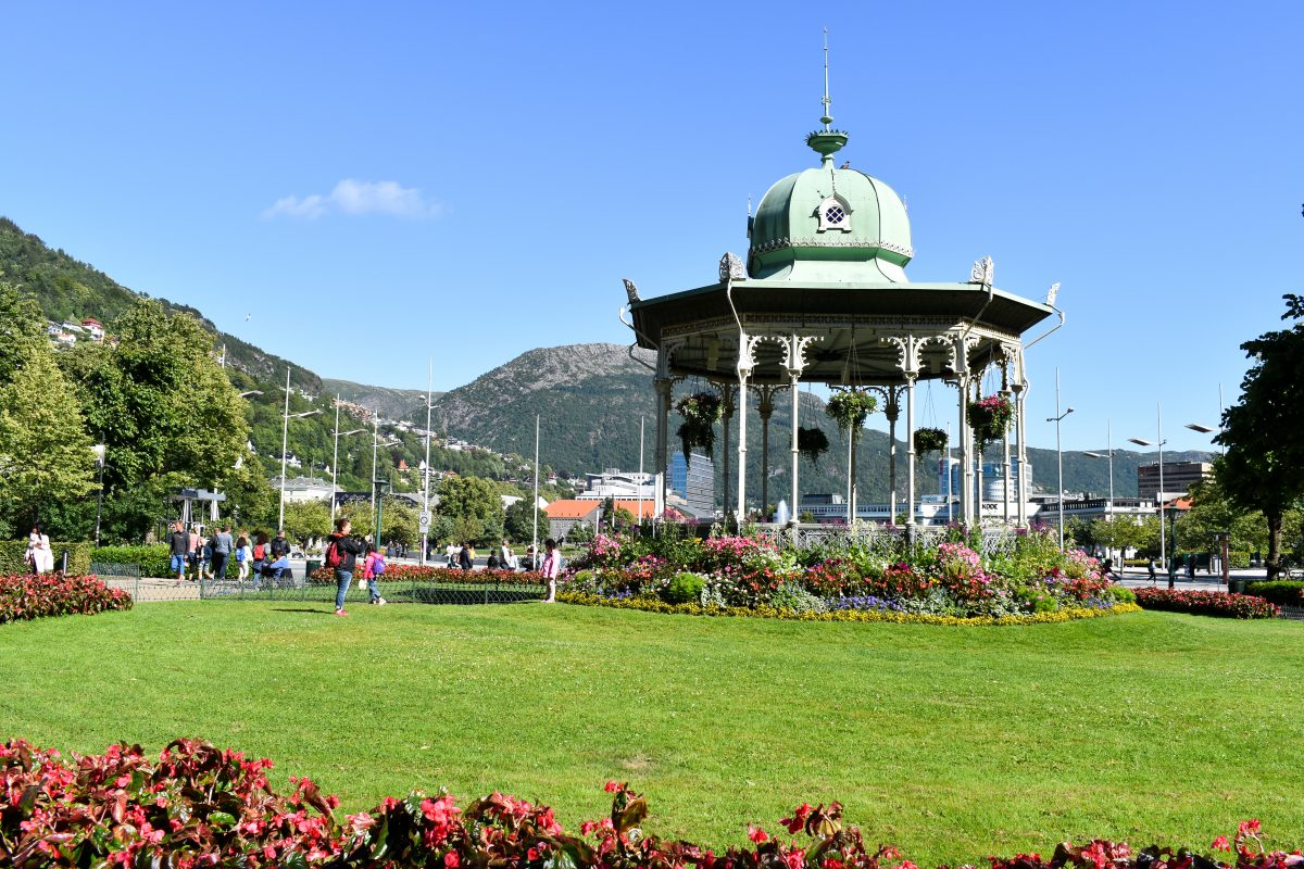 A large floral covered gazebo in a lush park in Bergen Norway