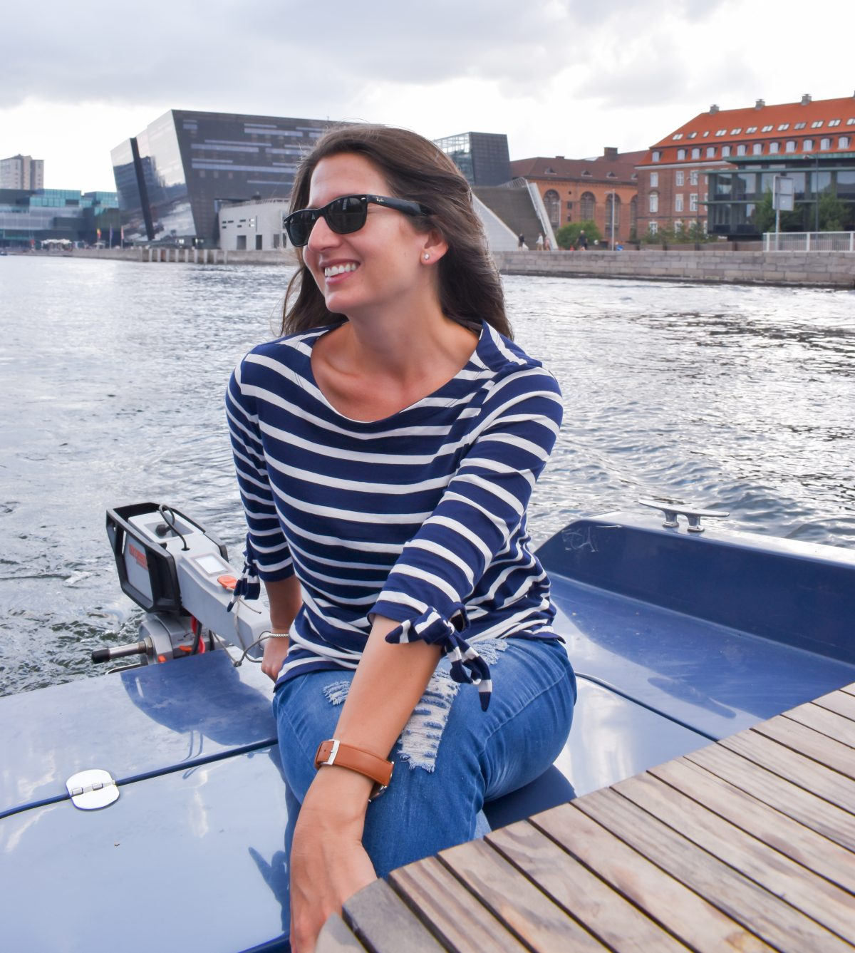 Erin drives a Go Boat through a canal in Copenhagen Denmark