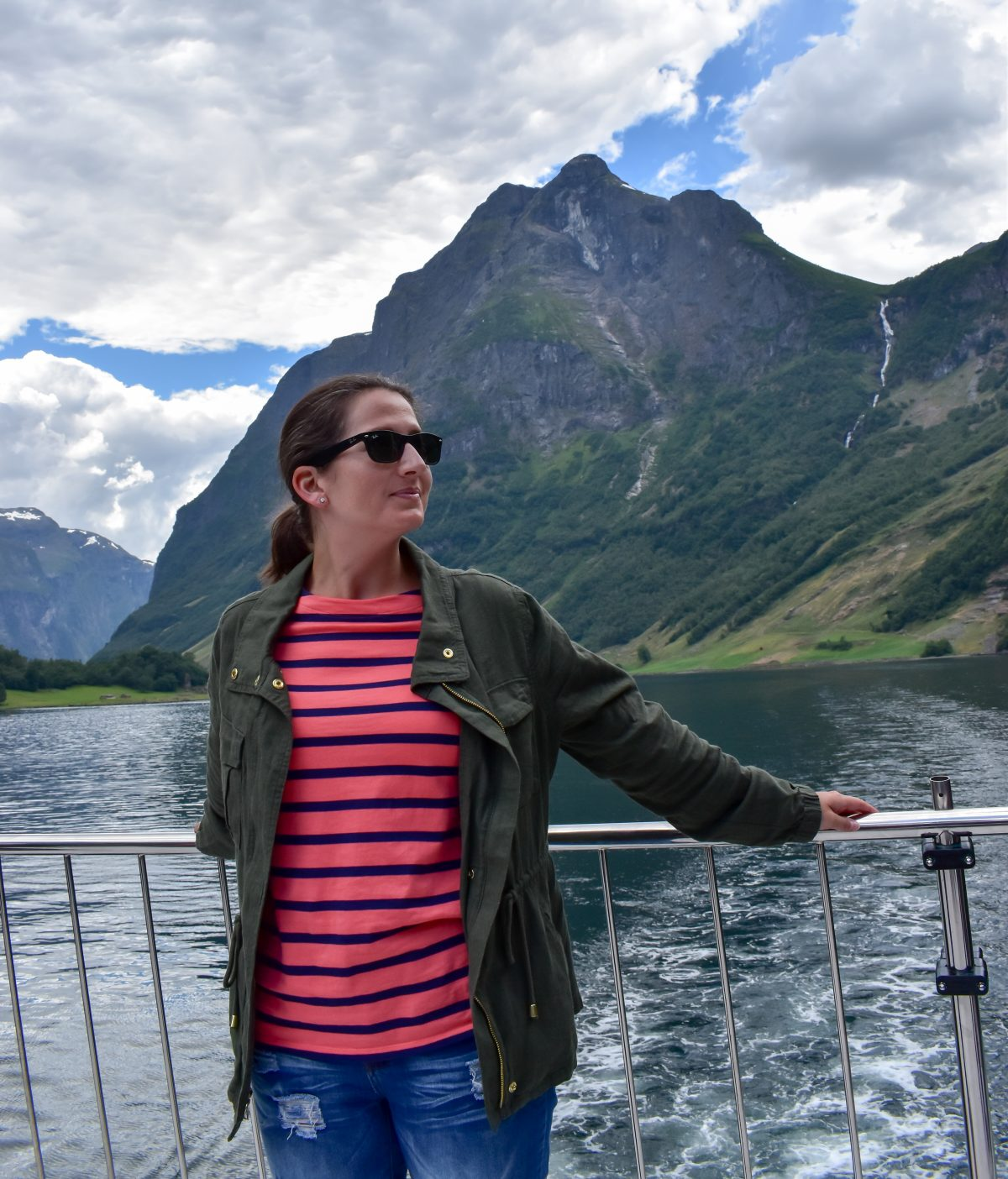 Erin wears a linen blend jacket over a nautical striped tee on a Fjord cruise in Norway.