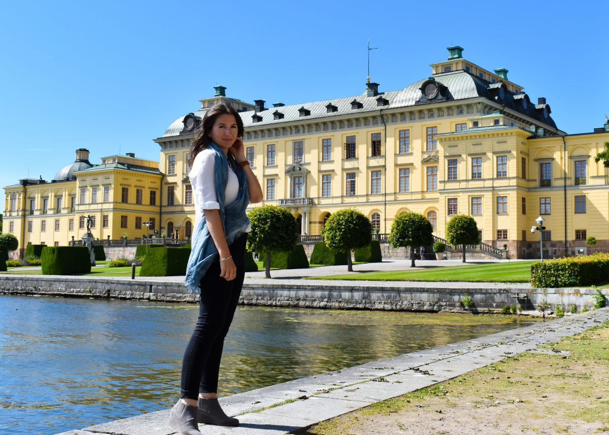 Erin stands before Drottningholm Palace in Sweden